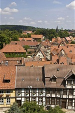 Preview iPhone wallpaper Welcome to Quedlinburg in Germany, houses, trees, clouds