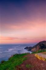 Beautiful sea sunset, coast, hilltop, red sky