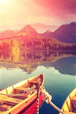 Preview iPhone wallpaper Lake, boats, pier, mountains, trees, water reflection, sunset, clouds