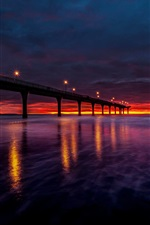 Preview iPhone wallpaper New Zealand, bay, bridge, lights, sunset, red sky, clouds