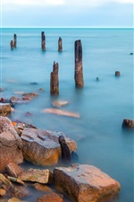 Preview iPhone wallpaper Sea, stump, dock, stones