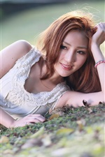 Preview iPhone wallpaper Smile Asian girl lying ground