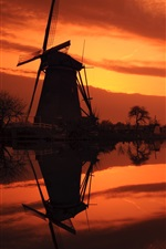 Preview iPhone wallpaper The Netherlands, windmills, river, red sky, evening