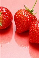 Preview iPhone wallpaper Three strawberries, sweet fruits