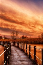Preview iPhone wallpaper Wooden bridge, river, grass, nature sunset, clouds, red sky