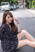 Preview iPhone wallpaper Asian girl sit at the road