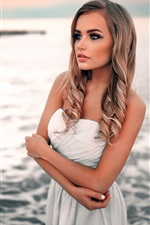 Preview iPhone wallpaper Beautiful white dress blonde girl at beach side