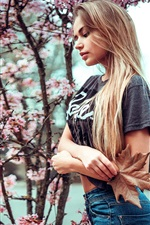 Blonde girl and cherry flowers