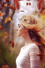 Preview iPhone wallpaper Blonde girl in autumn, leaves flying, wind