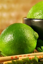 Preview iPhone wallpaper Fresh fruit, lime, green lemon, leaves