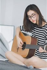 Preview iPhone wallpaper Girl play guitar sit on bed, Asian girl, glasses