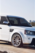 Preview iPhone wallpaper Land Rover white car at city beach
