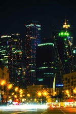 Preview iPhone wallpaper Moscow city night, Russia, road, houses, skyscrapers, lights, illumination