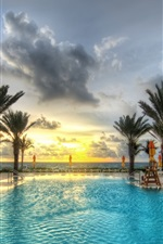 Preview iPhone wallpaper Palm trees, swimming pool, resort, sunset, clouds, sea