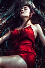menina saia vermelha dormindo debaixo da árvore