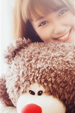 Preview iPhone wallpaper Smile Asian girl and teddy bear