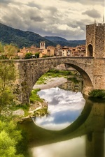 Preview iPhone wallpaper Spain, Catalonia, Fluvia river, houses, bridge, grass, clouds