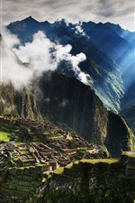 Preview iPhone wallpaper Travel to Peru, Machu Picchu, mountains, fog, morning, sun rays