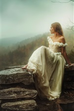 Preview iPhone wallpaper White dress girl sit at stone, height, mountains, dawn, fog