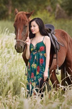 Preview iPhone wallpaper Asian girl and horse in the grass