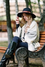 Preview iPhone wallpaper Blonde girl sit on bench