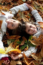 Preview iPhone wallpaper Children, two smile little girls, joy, leaves, autumn