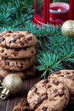 Preview iPhone wallpaper Christmas food, chocolate cookies, tree branches, balls, candle