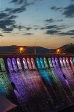 Dam night, rainbow-colored lighting