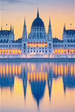 Preview iPhone wallpaper Hungary, Budapest, Parliament, water reflection, river, lights, clouds, dawn