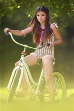 Preview iPhone wallpaper Lovely little girl riding bike