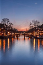 Preview iPhone wallpaper Netherlands at evening, city, houses, river, bridge, lights, moon