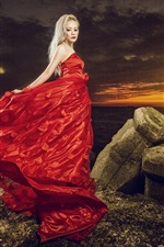 Preview iPhone wallpaper Red dress girl at sunset coast, stones