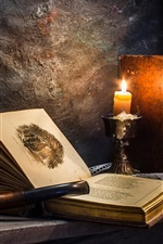 Preview iPhone wallpaper Room, old book, candle, firelight, retro style