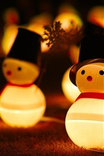 Preview iPhone wallpaper Snowman toys, lights, night