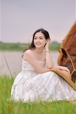 Preview iPhone wallpaper White dress Asian girl sit in grass, brown horse