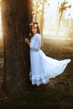 Preview iPhone wallpaper White dress girl in the forest, wreath