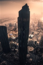 Preview iPhone wallpaper Abu Dhabi, city, skyscrapers, sun rays, morning, United Arab emirates