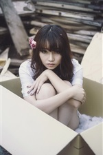 Preview iPhone wallpaper Asian girl in box