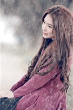 Preview iPhone wallpaper Asian girl sit at street, rainy day
