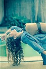 Curly hair girl, legs, levitation, magic