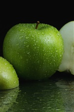 Preview iPhone wallpaper Green apples, water drops, fruit close-up