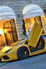 Lamborghini Aventador LP700-4 yellow supercar at street, doors opened