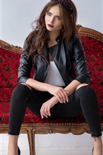 Preview iPhone wallpaper Leather jacket girl sit on sofa