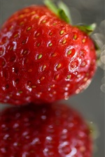 Preview iPhone wallpaper One strawberry close-up, glare background