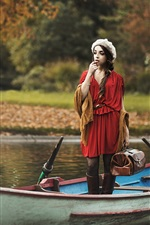 Preview iPhone wallpaper Red dress girl in a boat