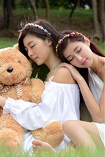 Preview iPhone wallpaper Three Asian girl sleeping with teddy bear