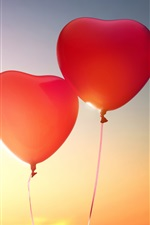 Preview iPhone wallpaper Two love heart shaped balloons in sky