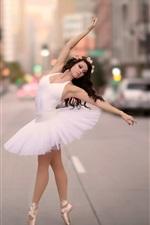 Ballerina dancing at city street