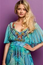 Blonde girl, smile, blue dress, purple background