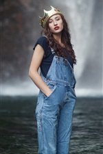 Curly hair girl standing in water